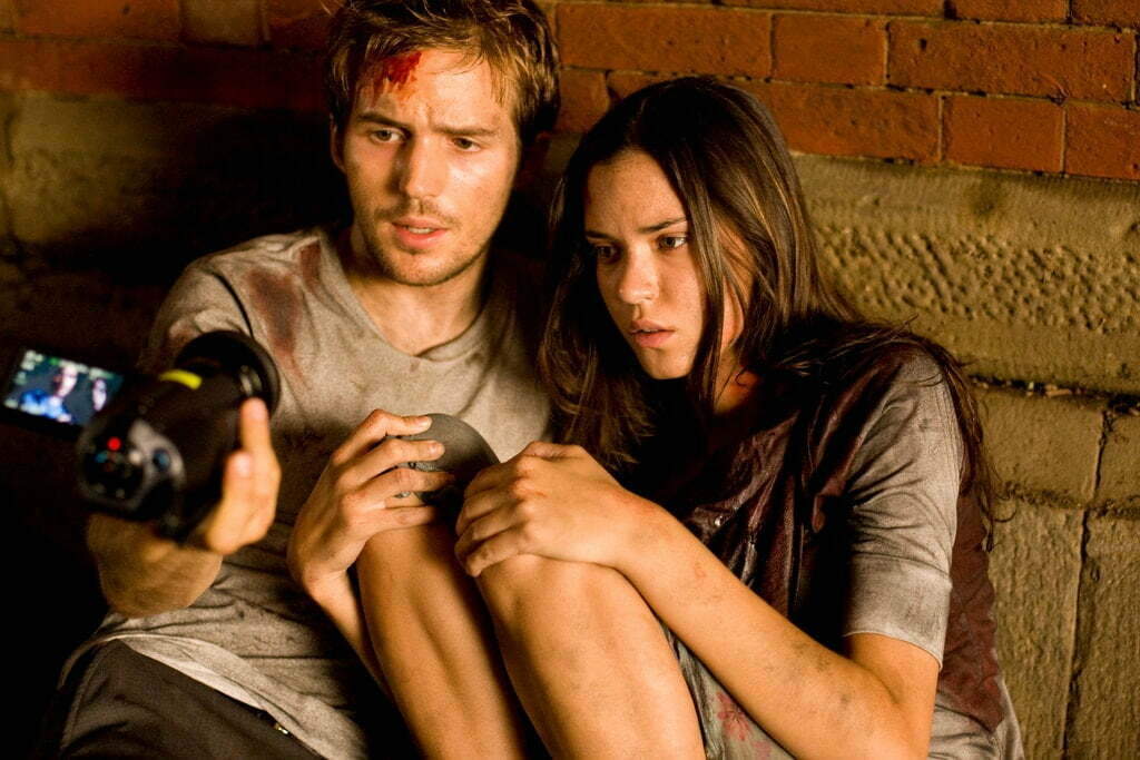 """Michael Stahl-David and Odette Yustman in """"Cloverfield.""""Credit...Sam Emerson/Paramount Pictures"""