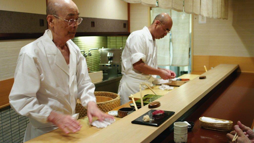 "Jiro Ono, left, and Yoshikazu Ono in the documentary ""Jiro Dreams of Sushi."" Credit...Magnolia Pictures"
